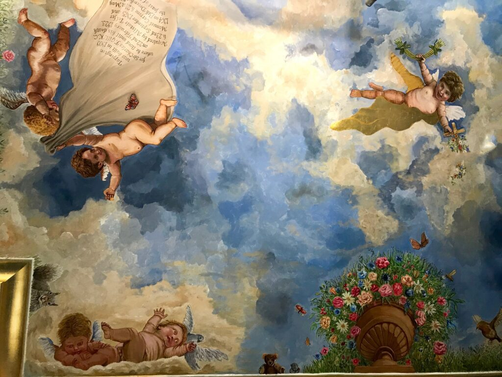 ceiling mural with sky and cherubs